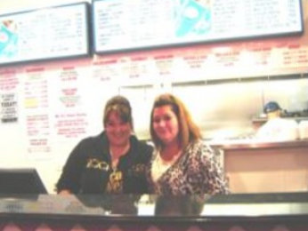Steph and Mrs C at counter at Mr C's Hot Dog Restaurant Elgin